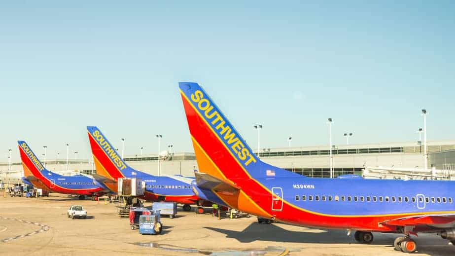42181214 - chicago, ilusa - april 11, 2015: three southwest airplanes parked at a chicago midway international airport mdw terminal.